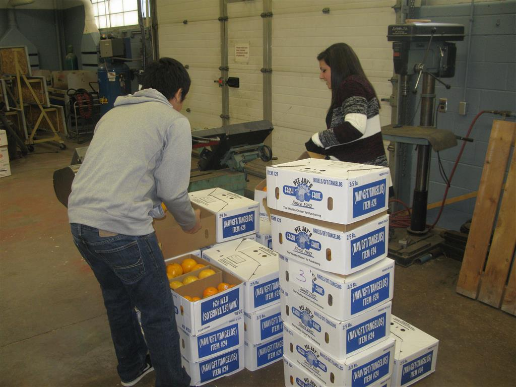 Students surpassed their goal of selling 470 boxes of fruit and cheesecakes.  As a group they had to work in 45 minute shifts to unload the truck, conduct quality assurance of each piece of fruit and package them back in the boxes correctly, and begin to pull orders for pick-up.  The committee had to have a plan in place, since the truck was arriving during the school day.  When the truck arrived, they committee chairman orchestrated the unloading with ease, as she knew where to place it grouping of fruit.  The committee then worked with the members to pull and load vehicles with boxes of fruit which had been hand checked earlier that day. In 36 hours the entire process was completed and the shop was back into action with projects.