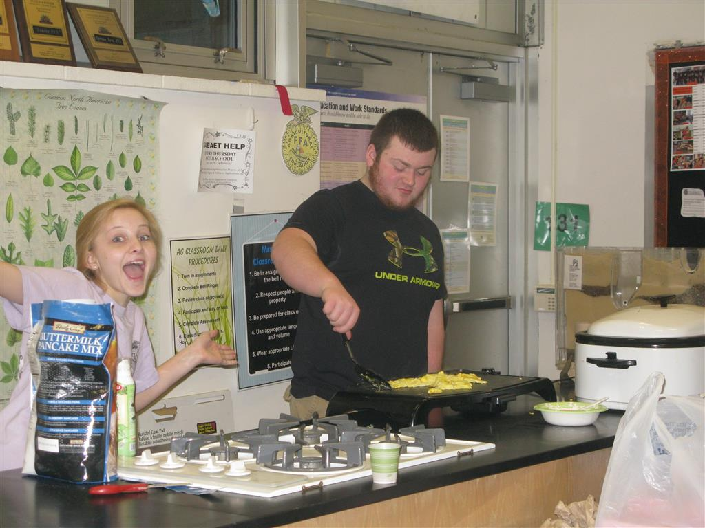 Maddie Veit excited about thanking the members while she and Daniel were cooking.  Maddie was the pancake making queen!