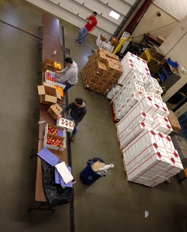 Once all the fruit was delivered members sorted through all the boxes of the fruit. Our mixed boxes contain apples, oranges, pears, and grapefruit.