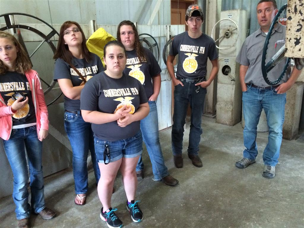 In this picture the officers of the Connersville FFA Chapter are visiting a local agriculture business.  In this photo members are learning how feed is mixed in at a local feed meal.  The purpose of this event was to learn more about the possible agriculture careers in our local area and develop a relationship with local business owners.