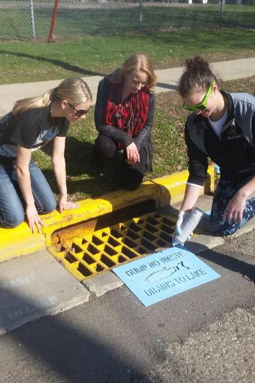 Members took part in helping the city of Beaver Dam by painting the storm drains in order to educate and raise awareness of the dangers of dumping items down the storm drains. In the picture, Jenny Swan, Shania Abler, and Alicia Braun are showing painting one of the storm drains in town.