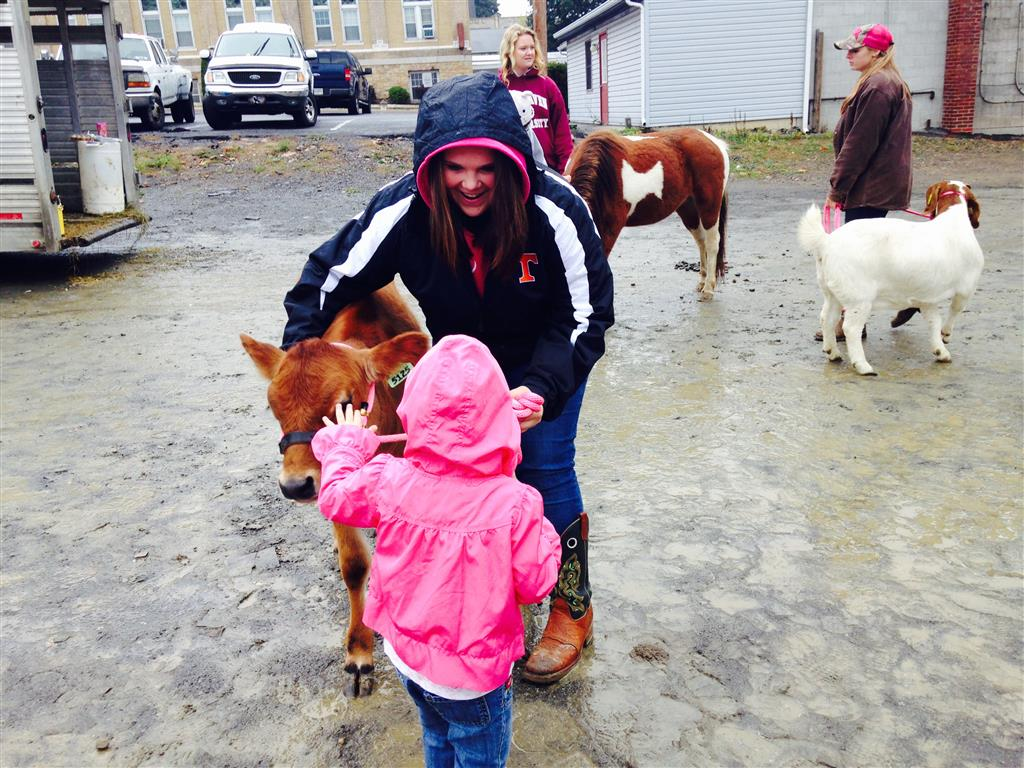 Those who braved the chilly, rainy weather on Saturday, October 3, 2015 were able to get up and close with some traditional farm animals at the Farm City Day in Tyrone.  Throughout the day, Tyrone Area FFA members spoke to children and adults about how you approach animals, their daily care, their uses, and even byproducts produced.  The members also assisted vendor with tent setups and teardowns along with carrying tables, trash cans, and overall grunt work.