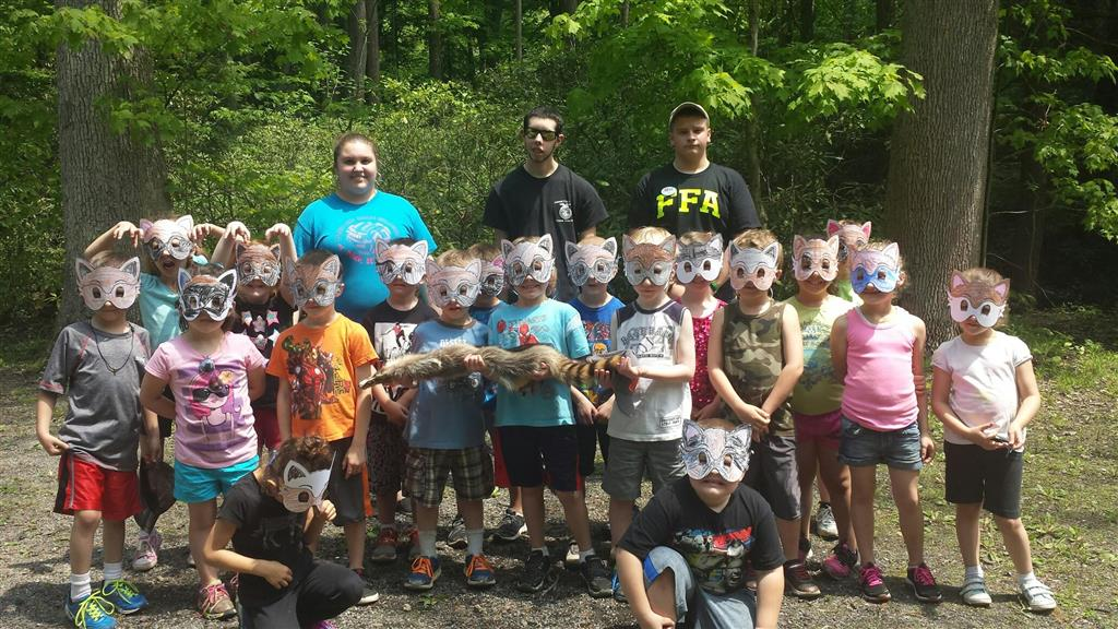 Kindergartens students were able to learn about the habitat of a raccoon and even become the mask bandit during the Environmental Excitement Day Raccoon Station.  Three high school educational students taught at each of the four FFA developed stations.  FFA members also taught kindergarteners about Butterfly Metamorphosis and used reading and recycling skills; how snakes are valuable to our environment and how to identify the rattlesnake, and how to plant a seed in soil, how to complete the label correctly and the care of the seed so it will grow into a productive vegetable this summer.