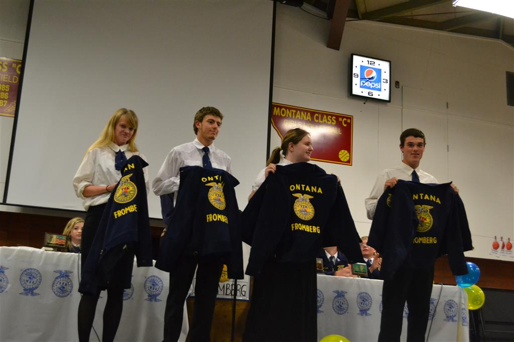 Senior members retiring their jackets.