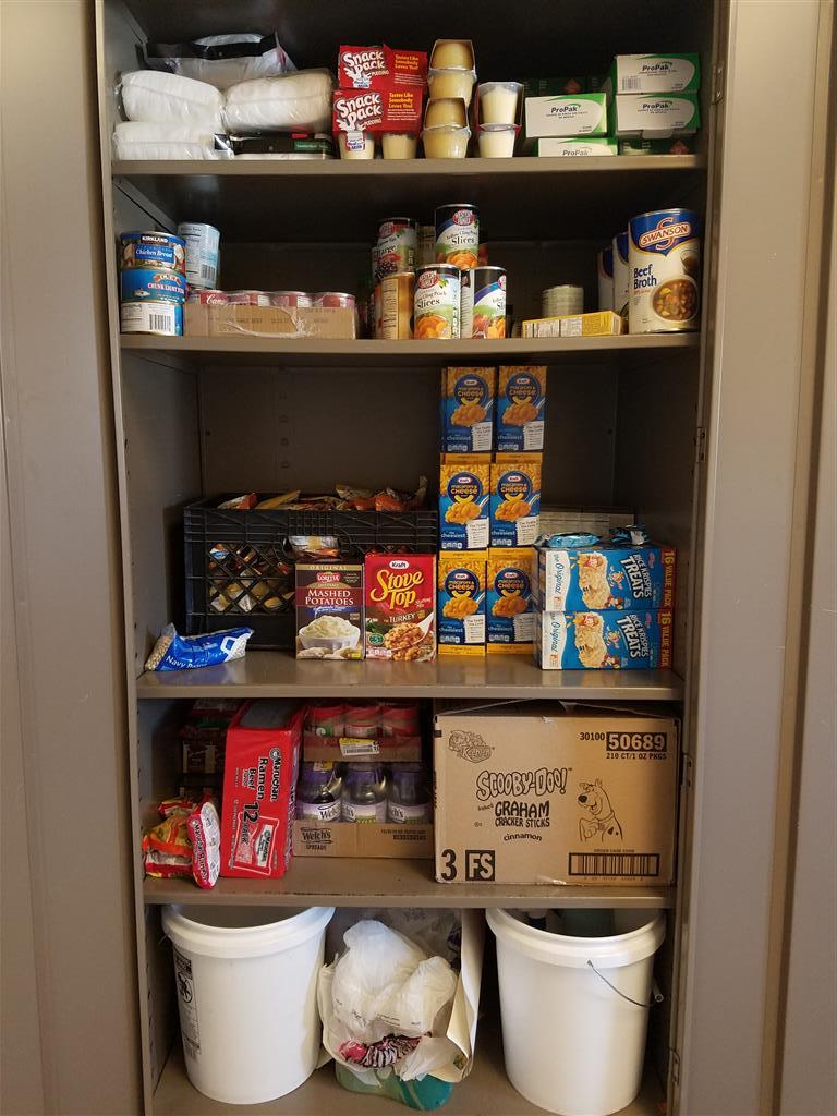 Our locker with dry goods and canned goods that we use for backpacks once a week.