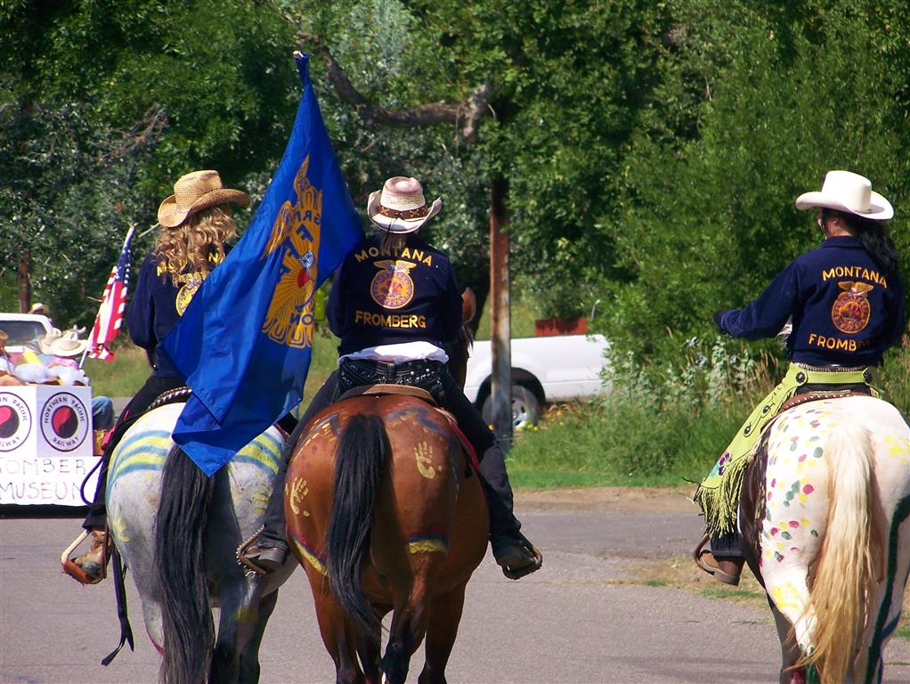Members ridding in the annual parade. They displayed the FFA flag.