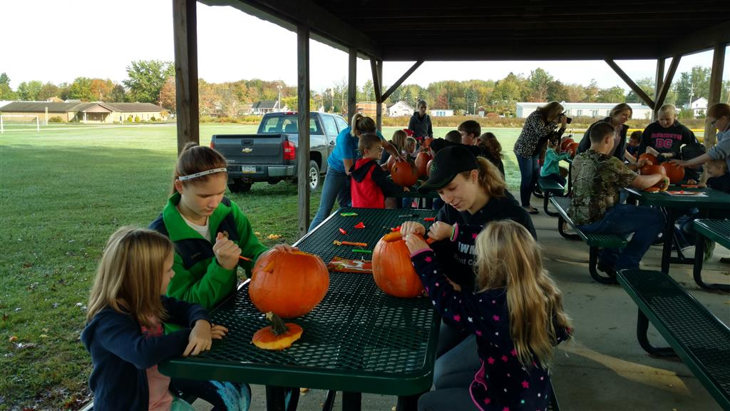 Carving the pumpkins with Northwestern Elementary kids.