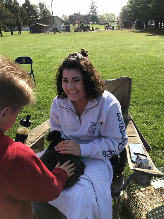 Rebecca Hough allowing students to pet her show chickens!