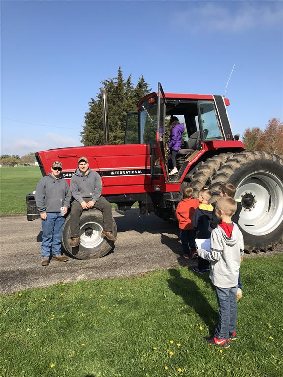 Garret Moser brought a tractor so students had the opportunity to sit in a tractor and see what farmers see driving on the road.